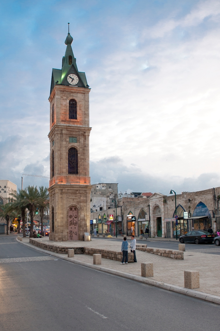 Jaffa Clock Tower just before sunset.  This is one of seven clock towers built in Israel during the Ottoman period. The tower was built to commemorate the silver jubilee of the reign of the Ottoman Sultan Abd al-Hamid II. The tower was built with contributions of the residents of the city, Arabs and Jews, headed by Joseph Bey Moyal.