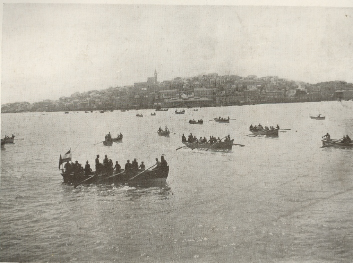 Boats waiting to take passangers ashore at Jaffa. Circa 1911.
