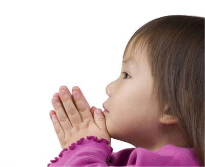 baby girl praying