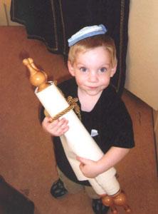 jewish boy holding torah