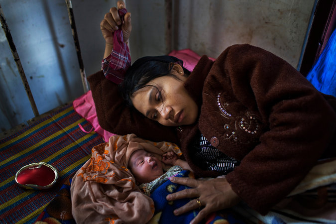 Lay Lay Win, 28, gave birth last month at a clinic in an area of Rakhine State where a health care crisis has grown worse. Credit Adam Dean for The New York Times